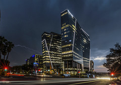 The Bowman, Sandton (Paul Saad) Tags: night exposure johannesburg sandton nikon street lights building architecture road city skyscraper sky sign intersection flickr tree longexposure thebowman paulsaad southafrica