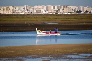 Fish boat with Faro as a back ground