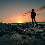 Staring at sunset - Skerries, Ireland - Color street photography thumbnail