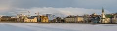 Reykjavík Panorama (Haraldur Ketill) Tags: reykjavík reykjavikpond parliament reykjavikfreechurch iðnó lake frozenwater frozenlake sunset sunsetcolors sunsetlight tamron 70200mm 70d mtesja esjan cranes