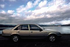Opel Rekord E2 1986 (KirstineLjung) Tags: analog agfa slide film dia iso100 car opel rekord 1986 e2 veteran clouds lake autumn fall xe7 minolta xe1