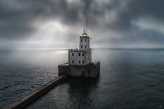 UNRAVELED (Nenad Spasojevic) Tags: sunrays wi wisconsin lakemichigan nenadspasojevic dji fun aerial drama above lake milwaukee unraveled lighthouse moody storm sun mood travel birds moods cloudy perspective water droning drone chicago illinois il usa