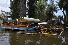 Canal boat graveyard (nickdippie) Tags: mexico xochimilco ciudaddemexico canal boat canalboat gondolier colourful