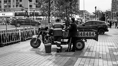 84 (Go-tea 郭天) Tags: qingdao huangdao men candid back backside night evening together friend friendship talk talking chat chatting old poor motorbike motorcycle seller cleaner buddy 84 numbers sidewalk street urban city outside outdoor people bw bnw black white blackwhite blackandwhite monochrome naturallight natural light asia asian china chinese shandong canon eos 100d 24mm prime duty job work trees cars