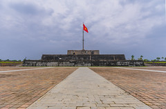 20171103_1073 (lgflickr1) Tags: citadel vietnam flag star hue old imperial weathered worn asia historic palace overcast clowdy walkway bricks architecture southeastasia northvietnam clowds lines