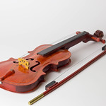 Violin on white table thumbnail