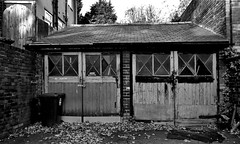 garage (Harry Halibut) Tags: 2017©andrewpettigrew allrightsreserved contrastbysoftwarelaziness noiretblanc blackwhite blancoynegro blanc weiss noire schwatz bw zwart wit bianco nero branco preto blackandwhite imagesofsheffield images sheffieldarchitecture sheffieldbuildings south yorkshire sheff1711064819 garage doors windows sheldon road black bin leaves autumn sharrow wood