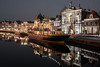 Christmas Comes But Once a Year (McQuaide Photography) Tags: haarlem noordholland northholland netherlands nederland holland dutch europe sony a7rii ilce7rm2 alpha mirrorless 1635mm sonyzeiss zeiss variotessar fullframe mcquaidephotography lightroom adobe photoshop tripod manfrotto light licht water reflection stad city urban waterside lowlight architecture outdoor outside waterfront building river spaarne riverside boat ship schip boot pakjesboot steamboat sinterklaas kerst christmas traditional authentic skyline house huizen residential night nightphotography teylersmuseum museum history historical rijksmonument