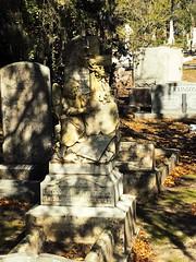 Sitting Angel | Ghastly Travels (ghastlyvongore1) Tags: angel cross grave graveyard cemetery history historic travel paranormal ghost haunted savannah georgia