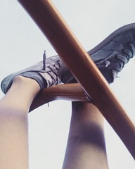 Hanging on.. barely. (Mary-Mel Knight) Tags: shoes feet outdoors hanging perception