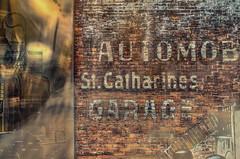 Relic (Paul B0udreau) Tags: canada ontario niagara paulboudreauphotography nikon nikond5100 photoshop nikkor50mm18 raw stcatharines stpaulstreet oldsign automobile garage blurlayer entranceway meridiancentre