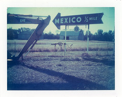Mexico, IN (moominsean) Tags: polaroid 190 instant type681 expired062000 indiana mexico midwest sign shovel corn cat lions
