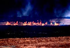 Fields Of Fire (M C Smith) Tags: field fire flames orange summer 1976 fields stubble smoke black trees slope hill sky blue