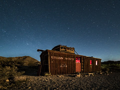 Ghostly Light Within (Rustic Lens Photography) Tags: california travel desert landscape nevada rhyolite ghosttown night stars train caboose red light explore nighttime long exposure ghost town