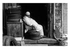 tired (handheld-films) Tags: india shopkeeper street candid portrait portraiture man people tyres sleep sleeping tired asleep muslim taqiyah rajasthan blackandwhite monochrome mono