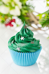 Green christmas cupcake with festive decorations (Aleksa Torri) Tags: christmas food cupcake background sweet cake festive dessert xmas icing cream decoration holiday sprinkles buttercream candy green baking celebrate christmastree concept confectionery cup event gift greeting homemade muffin newyear ornate party pastry recipe seasonal swirl tradition whipped winter holly noel red stars baked glitter shape white mistletoe wreath blue