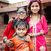 Three children pose for a photo in Fatehpur Sikri
