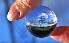 At my fingertips (Leve Lumen) Tags: macromondays fingertips power electricity energy pylon lens sphere blue clouds