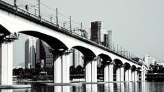 Bridge over Han River, Seoul (raisalachoque) Tags: bridge water river han seoul building cityscape urban arch architecture traffic 7dwf
