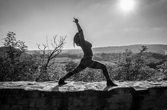 yoga time (taxtamas) Tags: monochrome blackandwhite yoga woman people outdoor wall castle girl tree trees hungary