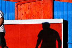 Omnia mea mecum porto (meghimeg) Tags: 2017 dianomarina uomo man ombra shadow sole sun rosso red azzurro blu blue legno wood