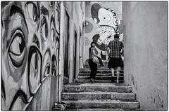 Au doigt et à l'oeil ! (bertranddorel) Tags: lisbonne portugal europe lisboa street streetphoto rue mono monochrome vie alfama town ville white people human humain gens personnes couple visage streetart art yeux oeil doight peinture dessin photoshop walk noiretblanc flickr nb bw bnw blackandwhite life marches steps