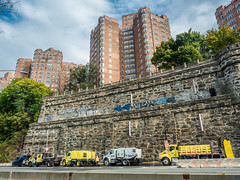 Henry Hudson Parkway at Castle Village Apartment Buildings, Washington Heights, New York City (jag9889) Tags: 2017 20171103 apartmentbuilding architecture barrier brick building car castlevillage dot departmentoftransportation graffiti henryhudsonparkway hirise house hudsonheights maintenance manhattan mural ny nyc nycdot newyork newyorkcity newyorkcitydepartmentoftransportation outdoor painting road rock sky streetart tagging tower tree truck usa unitedstates unitedstatesofamerica uppermanhattan vehicle wahi wall washingtonheights jag9889