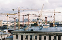Cranes. Saint Petersburg, August 17 (arsenterzyan) Tags: russia saintpetersburg 35mm grain film portra160 kodak eos3 canon 70200 street city development cranes