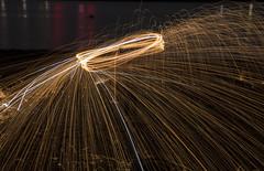 Light Painting (Cath Dupuy) Tags: crossharbour london isleofdogs lightpainting lightpainters spinningwool steelwool beach river riverthames 02 water reflections thames sparks orbs fireworks nightphotography longexposure