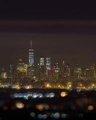 In the distance, through the haze. (stephen_tvedt) Tags: newyorkcity newyork newyorkphotography newjersey oneworldtrade oneworldtradecenter freedomtower night nightphotography longexposure bokeh