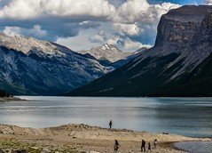 Mountain and lake (Jane Olsen) Tags: mountain clouds water lake beach people man woman outdoor alberta landscape serene