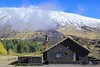 Etna _ shelter at the foot of the snow-capped volcano (piero.mammino) Tags: etna sicilia sicily vulcano volcano rifugio shelter galvarina alberi tree autunno inverno fall autumn winter biciclette bicycle byke neve snow nuvola cloud nebbia fog fumo vapore steam lava grass erba mountain sky stratovolcano lavaflow volcanicshelter geology earthscience