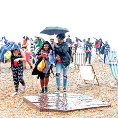 A sudden downpour (Finding Chris) Tags: chrisbarbaraarps canon60d pride beach brightonandhove east sussex august rain umbrella deckchairs onthebeach
