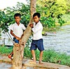 Two Boys (diamonds_in_the_soles_of_her_shoes) Tags: boys teampilipinas river cambodia siemreap