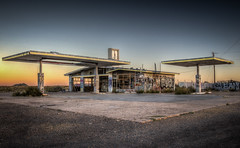 Abandoned gas station at Two Guns Ghost Town (donnieking1811) Tags: arizona winslow twogunsghosttown ghosttown gasstation fillingstation abandoned abandonedbuilding outdoors sky graffiti twilight dusk hdr canon 60d lightroom photomatixpro