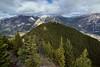 Hillsides, a Valley and Mountain Peaks (Banff National Park) (thor_mark ) Tags: nikond800e lookingnw day2 triptoalbertaandbritishcolumbia banffnationalpark capturenx2edited colorefexpro stoneysquawmountain rockymountains canadianrockies centralfrontranges sawbackslateranges sawbackrange sulphurmountain southerncontinentalranges southbanffranges sansonpeak cascademountain vermilionrange mountlouis mountedith mountcory mountnorquay bowriver river outside nature landscape blueskieswithclouds rollinghillsides mountains mountainsindistance mountainsoffindistance hillsides trees hillsideoftrees evergreens project365 atopsulphurmountain alberta canada