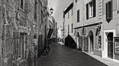 Alghero - Sardinia (frankdorgathen) Tags: alghero sardinia italy summer building house architecture old vintage monochrome blackandwhite city town urban street streetphotography pavement stone brick