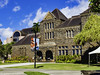 The Bishop Museum (Thad Zajdowicz) Tags: leica zajdowicz honolulu hawaii travel bishopmuseum building architecture stone windows usa color blue green colour sky clouds lawn lamppost availablelight lightroom outdoor outside history grass tree garden sign