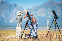 Young man helps another male photographer set up his camera, Grand Tetons National Park, Teton County, Wyoming (Remsberg Photos) Tags: eclipse grandteton jackson landscape mountains nationalpark solar tetons west wyoming colorimage grandtetonnationalpark tetonrange mountainrange rockymountains mountain nature westernusa jacksonhole photographers largegroupofpeople cameraequipment digitalcamera dslrcamera people adventure photographing technology travel tourism horizontal outdoors traveldesintations twopeople onlymen together assist aid usa