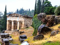 Delphi - Athens Treasury (CaptSpaulding) Tags: greece delphi old ancient historic building buildings statue stairs rain sky canon color contrast clouds closeup athens bank treasury tree animal grass