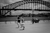 Sydney Harbour Bridge......   jogging on the forecourt (cupitt1) Tags: sydney harbourbridge harbour bridge coathanger icon aussie australia operahouse jogging running jog exercise summer bench view black white monochrome fujixpro1 fuji xpro clouds cupitt1 dave street lamp streetlight contrast