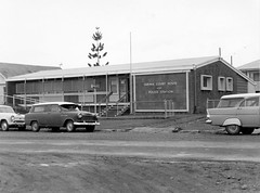 Cars parked outside Court house and Police station in Sarina (Queensland State Archives) Tags: police court monochrome sarina 1963 retro car automobile stationwagon