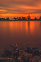 Dusk at the Riverside (Marc Braner) Tags: ifttt 500px sky red sunset water reflection river sun light clouds twilight orange silhouette evening germany long exposure riverside dusk backlit dramatic rhine riverbank moody