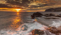 Reclaimed (Pureo) Tags: bridge canon canon6d clouds coast dusk exposure flowing goldenhour glow island landscape leefilters overflow portugal rocks seascape sea sky sunset silky waves sun madeira rockyisland