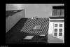 _8025483 b&w copy A-1 (Michael Fleischer) Tags: city roof detail windows chimney monochrome sidelight