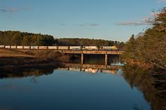 Nequasset Glint (jc_canon) Tags: centralmainequebecrailway centralmainequebec cmq cmq2002 cmq2006 geb237 ge b237 woolwichmaine nequassetreservoir rocklandbranch bridge railroadbridge reflection train freighttrain