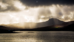 In the Spotlight (Augmented Reality Images (Getty Contributor)) Tags: hebrides shadow isleofskye scotland leefilters dunvegan westcoast water island contrast storm canon rain light clouds unitedkingdom gb