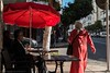Pink Djellaba and Red Umbrella (elrick.williams) Tags: 2017 bar cafe casablanca morocco pinkdjellaba redumbrella leicam10 50mmsummilux sidewalkcafe woman men sunshine