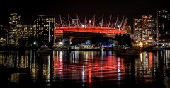 These city lights...... (Christie : Colour & Light Collection) Tags: bcplacestadium false creek bclions nikon remembranceday red honor vancouver britishcolumbia bc canada nightphotography nightlights canadianfootballleague sports commonwealthofnations cityscape night evening outdoors reflections apartments condos skyscrapers stadium firstworldwar veterans winter 2010winterolympics 2010paralympics cfl boats yachts nautical buidings sparkle