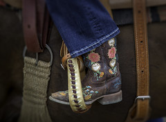 Cowgirl (crabsandbeer (Kevin Moore)) Tags: americana animals battleofthebeast bull bullriding children cowboy horse kids newmarket people rodeo rural smalltown speed sports unionbridge violence shoe boot cowboyboot girl barrelrider saddle tack embroidery closeup stilllife stirrup